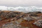 stock photo of iceberg  - Arctic landscape in Greenland around Disko Island with icebergs ocean mountains and cloudscape - JPG