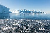 picture of iceberg  - Beautiful Icebergs in Disko Bay Greenland around Ilulissat with blue sky - JPG