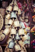 stock photo of edelweiss  - Decoration Metal bells from Zakopane in Poland - JPG