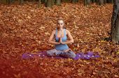 pic of namaste  - Young blond woman in blue t - JPG