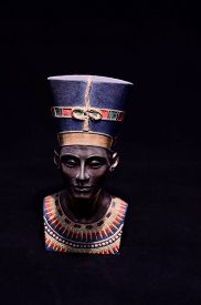 foto of nefertiti  - Famous Statuette Bust of Queen Nefertiti Isolated on Black Background - JPG