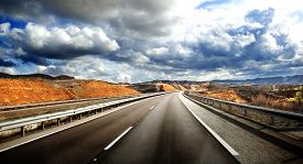 stock photo of cloudy  - Road scenery - JPG