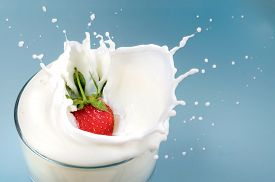 stock photo of freezing  - Fresh strawberry drops in milk with splash - JPG