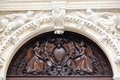 stock photo of woodcarving  - Woodcarving above the entrence of the Notre - JPG