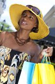 foto of young black woman  - Beautiful and fashionable African American woman with colorful shopping bags - JPG