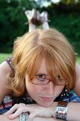 pic of clevage  - a beautiful young redhead with glasses and a cute smile - JPG