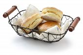 image of devonshire  - homemade scones in a basket on white background - JPG