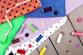 Items For Sewing Clothes. Sewing Buttons, Spools Of Thread And Cloth. Top View. poster