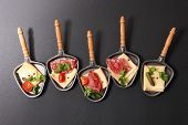 assorted spoon of raclette cheese poster
