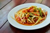 picture of green papaya salad  - Thai papaya salad hot and spicy mixed from variety of vegetable closeup - JPG