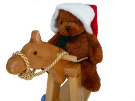stock photo of horse wearing santa hat  - Teddy wearing a Santa hat riding his horsey - JPG