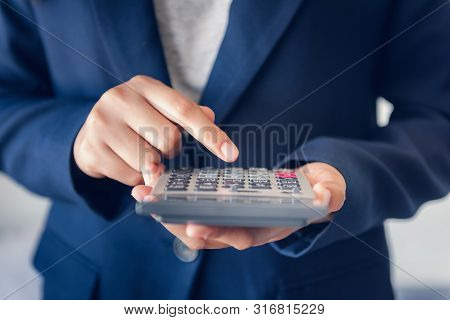 poster of Close-up Of Business Accountant Financial Using Calculator For Estimated Tax Earning Account, Entrep
