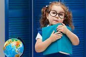 Smart Toddler Kid. Back To School And Happy Time! Cute Industrious Child In Glasses Is Sitting At A  poster