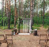Wedding Decoration In The Garden. Modern Wedding. Wedding In The Wood. Wedding Arch Decorated With F poster