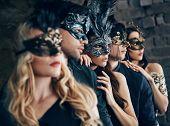 Group Of People In Masquerade Carnival Mask Posing In Studio. Beautiful Women And Men Wearing Veneti poster