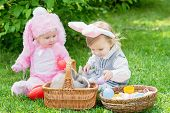 Children Play With Real Rabbit. Laughing Child At Easter Egg Hunt With Pet Bunny. Little Toddler Gir poster