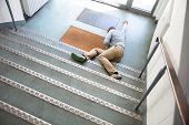 Unconscious Man Lying On Staircase After Slip And Fall Accident poster