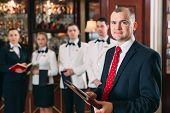 The Interaction Of The Staff. Hotel Or Restaurant Manager And His Staff In Kitchen. Interacting To H poster