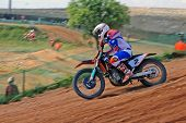 stock photo of dirt-bike  - Motorcycle rider hiting the dirt on the track.