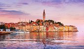 Rovinj Croatia. Sunrise sky above vintage town at Istria peninsula in Adriatic Sea. View from water  poster