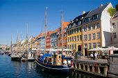 picture of street-walker  - Nyhavn street and chanel in Copenhagen Denmark - JPG