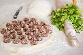 Homemade Dumplings In A Dumpling. Dumplings With Minced Meat On A Table Sprinkled With Flour. Select poster