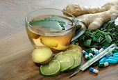 Ginger Tea. Cup Of Ginger Tea, Ginger Root, Lime, Mint, Thermometer And Pills On A Wooden Table. Alt poster