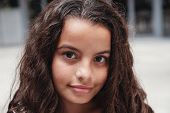 Close Up Portrait Of A Confident, Charming And Gorgeous Mixed Multicultural Preteen Girl With Beauti poster
