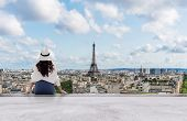 Young Traveler Woman In White Hat Looking At Eiffel Tower, Famous Landmark And Travel Destination In poster