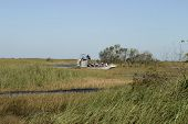 image of airboat  - an airboat in the florida everglades with a full load of people on a tour to view alligators and other wildlife - JPG