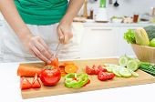 Cooking. Young Pretty Woman In Green Shirt Cutting Cooking And Knife Preparing Fresh Vegetables Sala poster