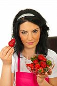 Beauty Woman Showing Strawberry