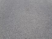 Light Gray Asphalt For Pavement. The Surface Of The Asphalt Is Smooth. Tarmac Construction Material. poster