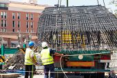 Steel Rebars For Reinforced Concrete. Construction Worker Unload From The Truck A Part Of Einforceme poster