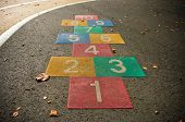 foto of hopscotch  - colorful hopscotch game on an empty schoolyard