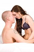 Young Couple Sitting Up In Bed Fondling poster