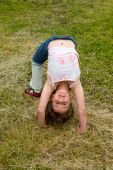 image of bending over backwards  - Little smiling girl - JPG