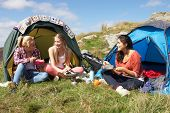 stock photo of 16 year old  - Group Of Teenage Girls On Camping Trip In Countryside - JPG
