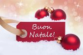 stock photo of natal  - A Red Label With the Italian Words Buon Natale Which Means Merry Christmas on It - JPG
