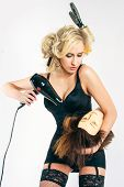 picture of brothel  - beautiful sexy blonde makes the hair to mannequin - JPG