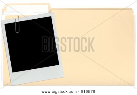 Picture or Photo of A file folder with a Instant photo Instant Picture attached