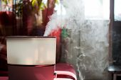 stock photo of ultrasonic  - Humidifier spreading steam into the living room - JPG