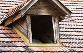 stock photo of gabled dormer window  - One antique roof window to the attic - JPG