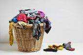 image of household  - Overflowing laundry basket - JPG