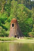 stock photo of wigwams  - Old lumber mill wigwam burner produced energy for a box mill in Oakland Oregon - JPG
