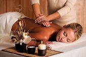 picture of backbone  - professional masseur doing massage of female back in the beauty salon - JPG