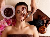 foto of female mask  - Spa therapy for young woman having cosmetic mask at beauty salon - JPG
