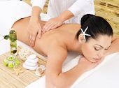 stock photo of backbone  - Woman having therapy massage of back in the spa salon - JPG