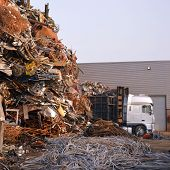 stock photo of scrap-iron  - Metal scrap yard with Truck in the industrial area - JPG
