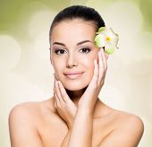 Beautiful young woman with healthy skin face. Skin care concept.
